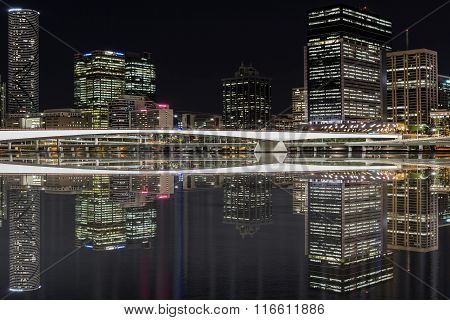 Brisbane City night cityscape and Victoria bridge reflections