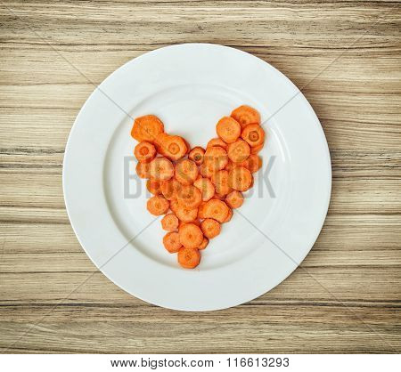 Sliced Carrots In The Heart Shape On The White Plate, Valentine's Day