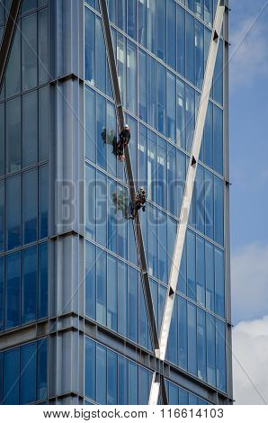 Abseilers On Broadwick Tower, London