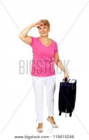 Smile senior woman with suitcase