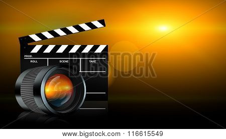 Lens And Clap Board On Dark Background