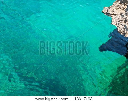 Turquoise Sea Water With Rock