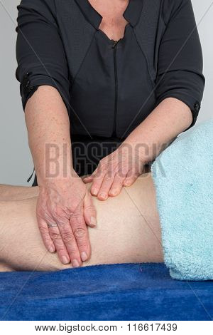 Female Physical Therapist At Work In Her Office