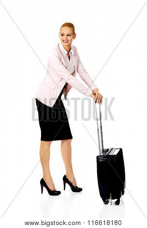 Young business woman waiting for travel with suitcase