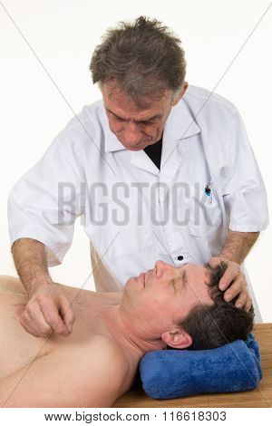 Male Undergoing Acupuncture For Health At Beauty Center