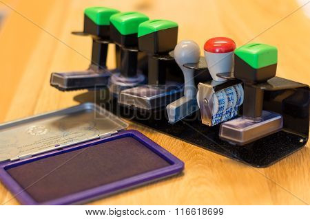 Various Stamps In Stamp Holder - Close-up