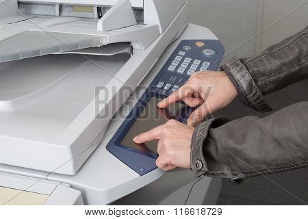 Businesswoman Operating Printer In Office At Work