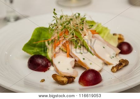 Appetizer Salad With Sliced Chicken And Grapes
