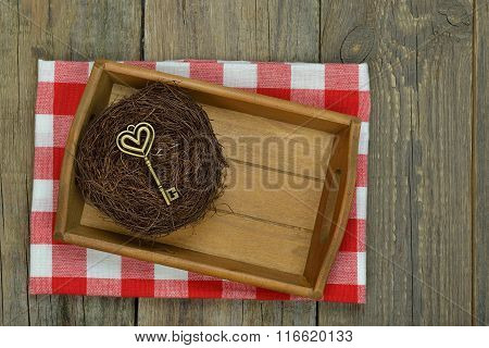 Tray And Key On Wooden Background