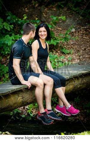 Couple relaxing after jogging