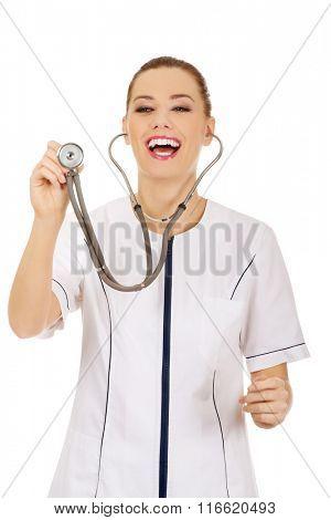 Smile female doctor or nurse using stethoscope