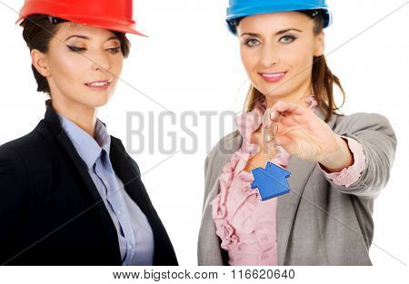 Two architects women with house key.