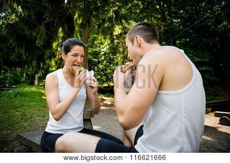 Eating together -  couple after jogging