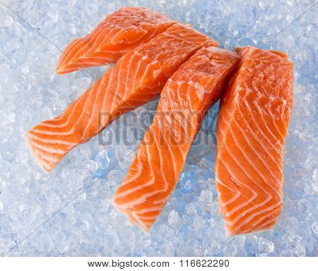 Fresh Salmon Fillets on crushed ice, close-up.