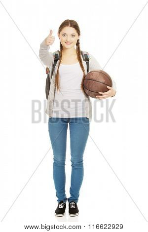 Young woman with basket ball.
