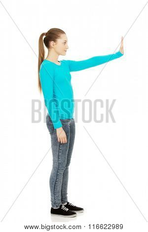 Young woman making stop sign.