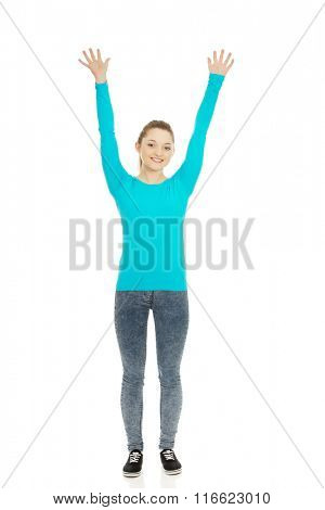 Young happy woman with hands up.