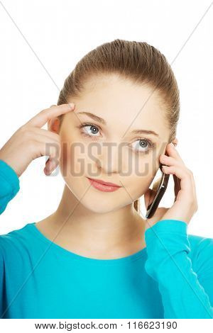 Thoughtful teen with mobile phone.