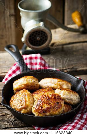 Chicken Cutlets On Frying Pan.