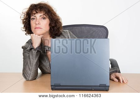 Middle-aged Woman Working At Work On Laptop
