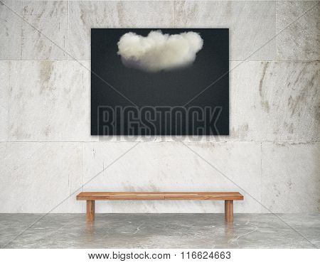 Black Picture With White Cloud On The Wall Above Wooden Bench On Concrete Floor