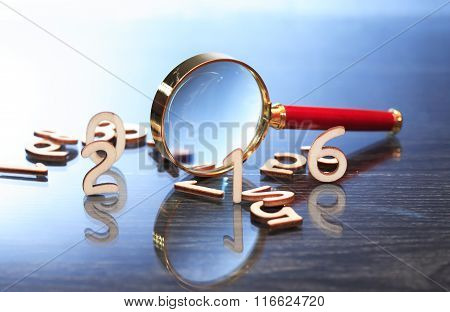 Magnifying Glass And Digits