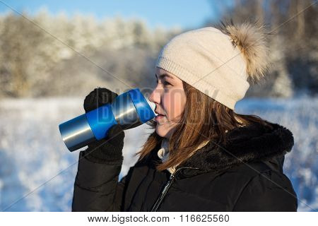Frost Concept - Beautiful Woman With Thermal Mug In Winter Forest