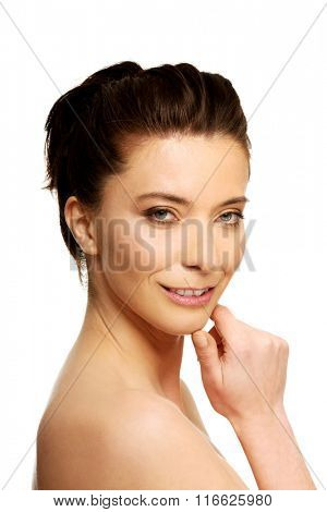 Beautiful toothy smiling woman with make up.