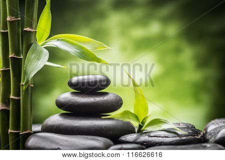 still life with zen basalt stones and bamboo .(focus on the stone)