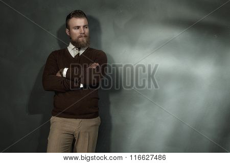 Confident Man Standing With Folded Arms