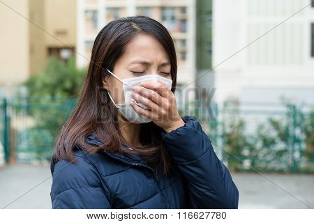 Young woman with face mask having cold