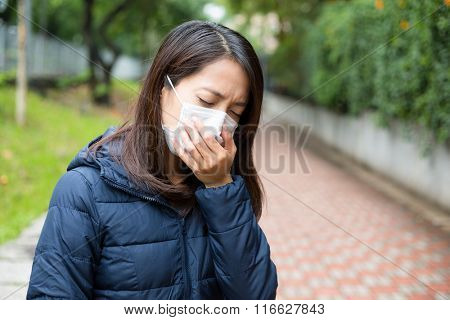 Young Asian woman with face mask