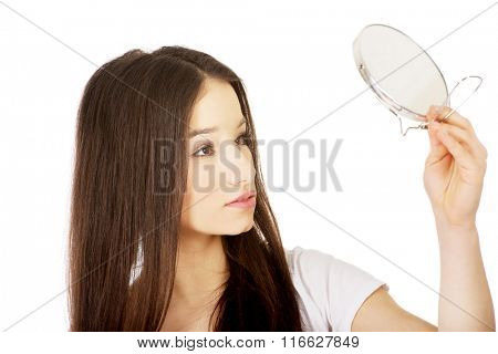 Young woman with mirror.