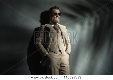 Elegant Bearded Man In A Cream Colored Suit