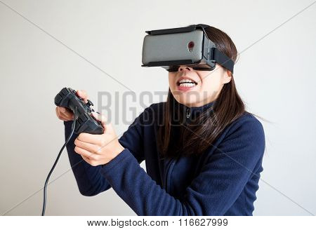 Woman wearing virtual reality play video game
