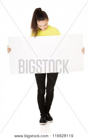 Young happy woman with blank board.