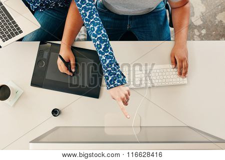 Hands Of Graphic Designers Working Together