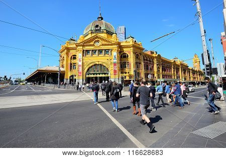 People and commuters on the street near the Flinders Street Station