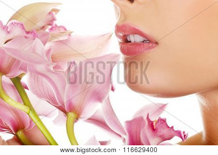 Beautiful woman with pink flower.
