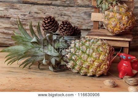Pineapple Sweet Fruit Delicious On Wood Background.