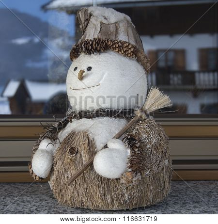 A Cheerful Snowman With Broom