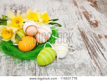Easter Eggs In A Nest With Flowers