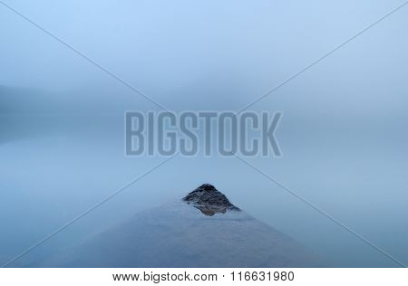 Stone in mountain lake at Caucasus, minimalism