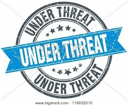 Under Threat Blue Round Grunge Vintage Ribbon Stamp