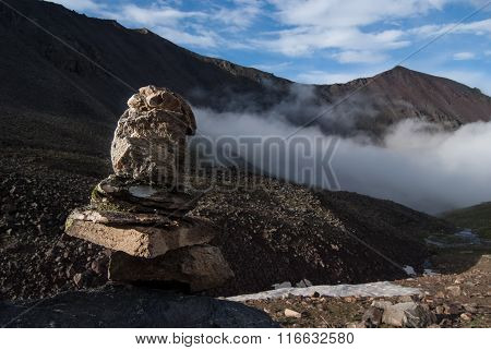 Cairn in a mountain valley