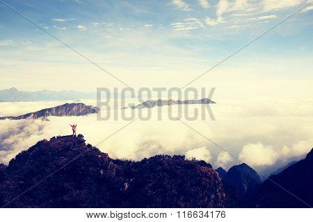 young woman hiker on beautiful mountain peak