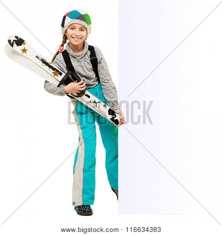 little girl wih skis pointing at an empty blank isolated on white background