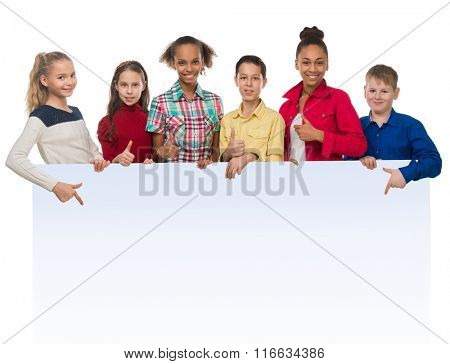 teenagers with thumbs up pointing at an ad blank isolated on white background