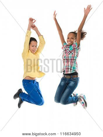 boy and girl with different complexion jumping isolated on white background
