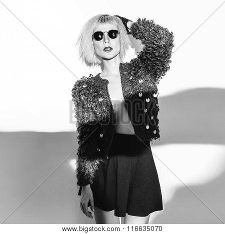 Glamorous Blonde in fashionable evening Wear.